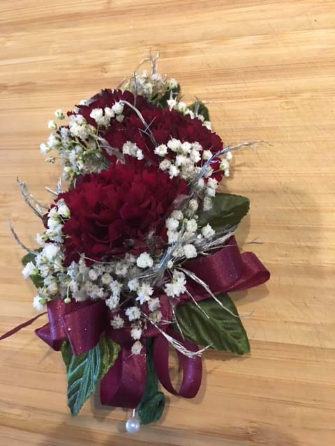 pin Corsage red carnations