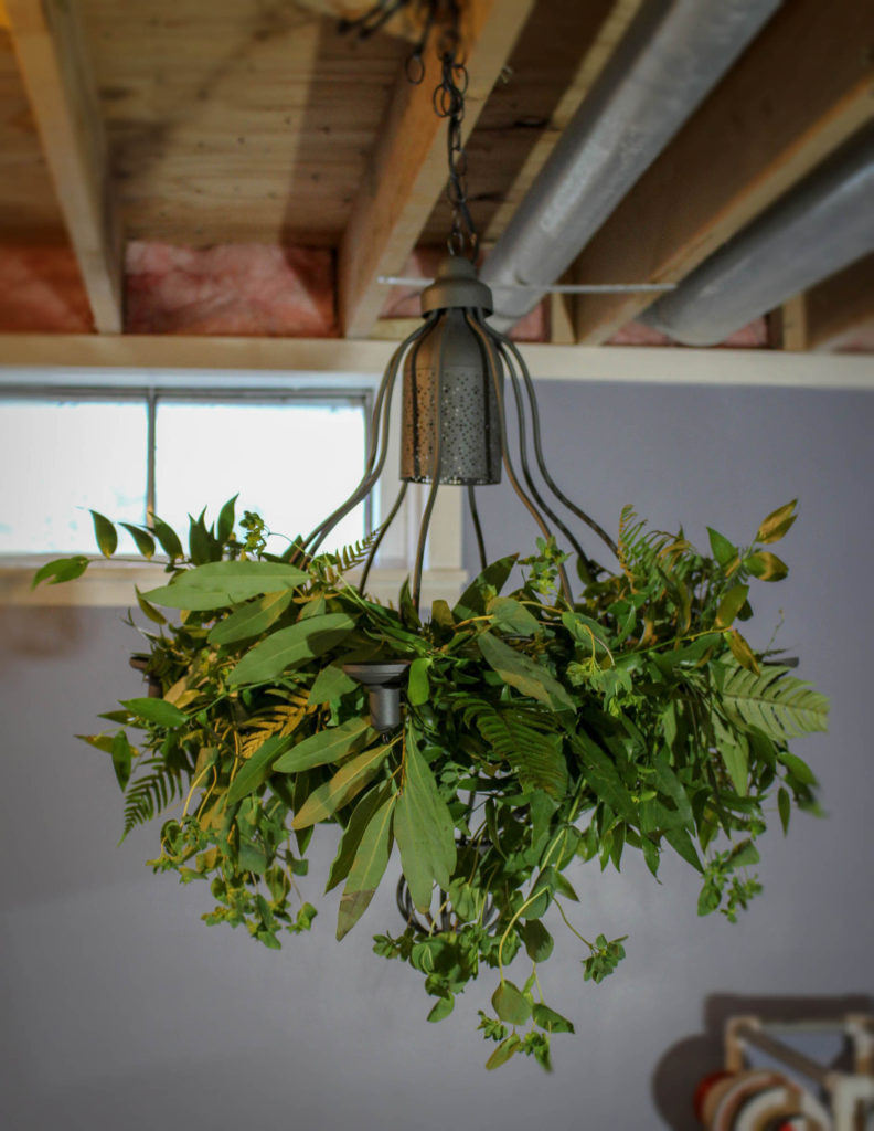 Greenery chandelier wedding rental floral design