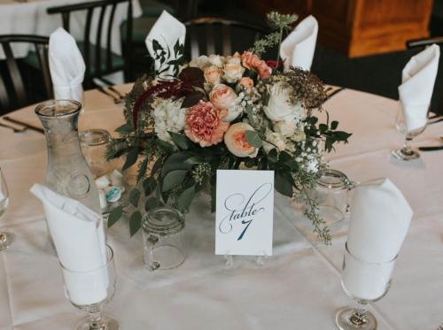 Burgundy blush wedding reception table centerpiece