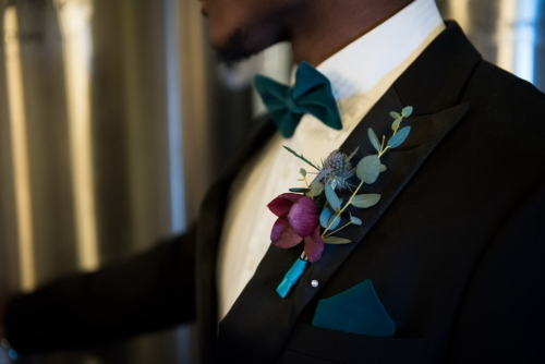 Groom suit bow tie teal boutonniere hellebore
