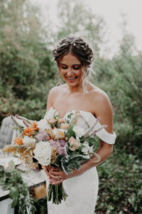 Bridal bouquet muted colors, peach, yellow, white, sage