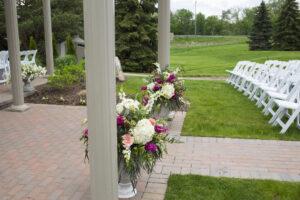 Outdoor ceremony flower arrangements pink white fuchia