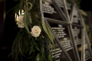 Seating chart decor wedding roses garland