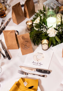 Wedding reception table setting white green gold candle