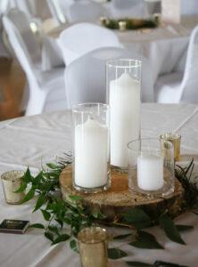 Table setting greenery wood candles rustic wedding