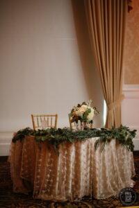 Sweetheart table decor wedding reception greenery garland
